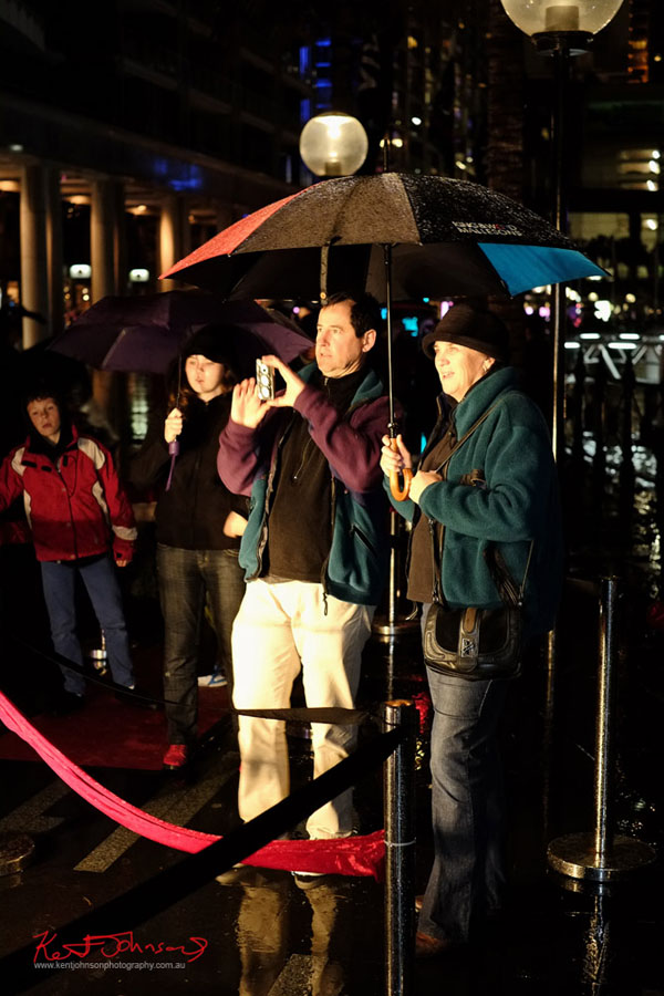 Family photographing Vivid Sydney 2013 with a smartphone camera in the rain. Fujifilm X-Pro1, XF35mmF1.4 R.