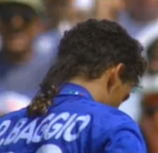 Roberto Baggio bows his head after missing his kick in the penalty shoot-out against Brazil at the 1994 World Cup