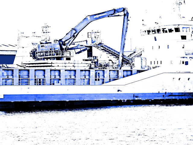 Cargo ship (being loaded with sand) adjusted into shades of blue and white.