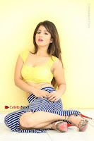 Cute Telugu Actress Shunaya Solanki High Definition Spicy Pos in Yellow Top and Skirt  0270.JPG
