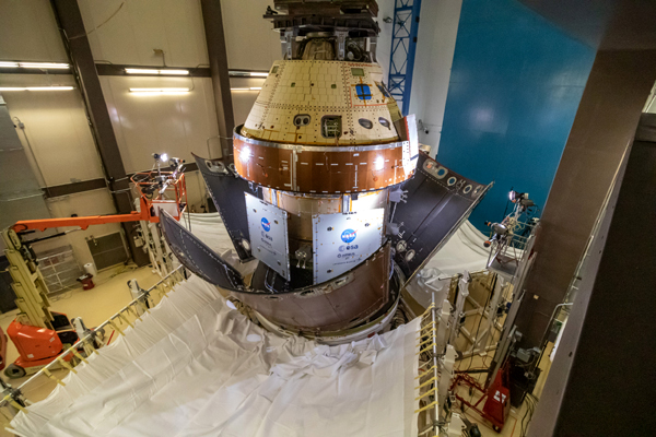 The three fairing panels that encapsulate Orion's service module during launch are jettisoned from the spacecraft's Structural Test Article during a demonstration at the Lockheed Martin facility near Denver, Colorado.