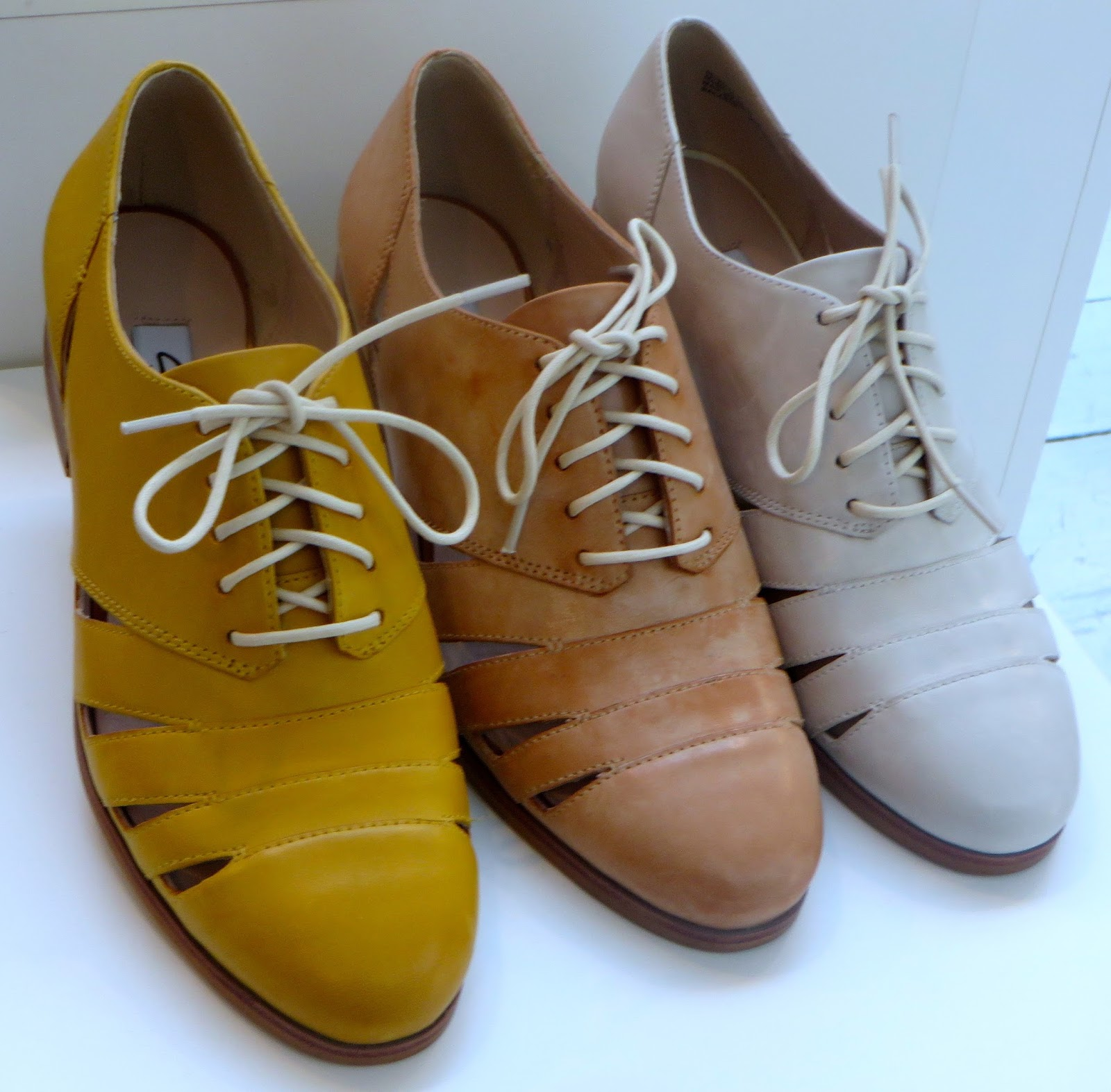 9afc6686b421 cut-outs in lace-up spring take on formal shoe-in pretty muted tones Hotel  Image---block heel