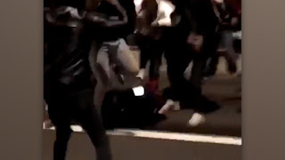 a policewoman being beaten on New Year's Eve