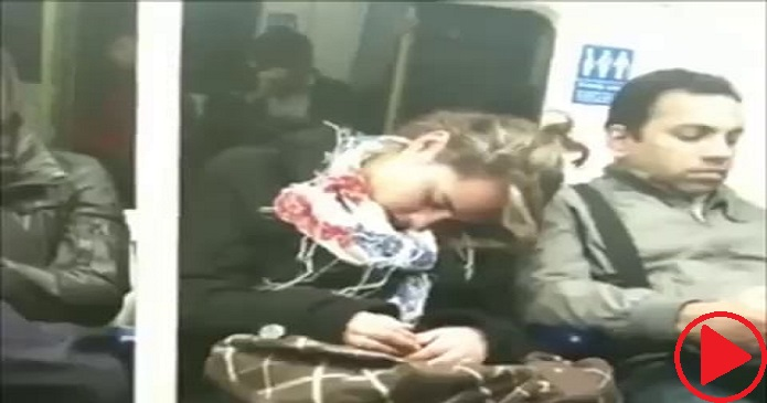 Sleepy London women snuggles up to total stranger.