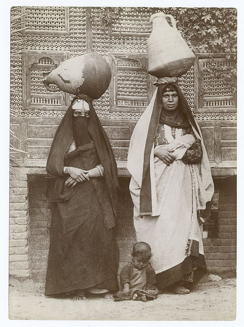 Fellah women, Egypt. 1860s-1920s. Notes: Typed on reverse and crossed out in pencil : The fellah women are geniuses in producing rising generations and foolish geese in rearing the brood.  The New York Public Library. Photography Collection, Miriam and Ira D. Wallach Division of Art, Prints and Photographs.
