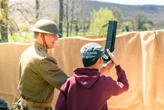 PMM educator shows student how to use trench periscope