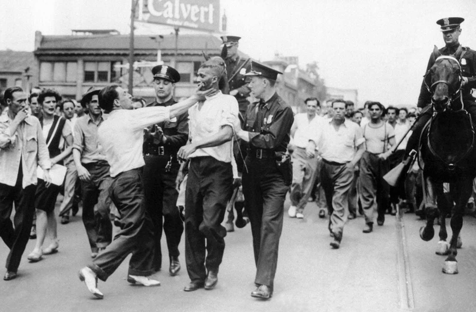Police attempt to break up an incident as race rioting flared in the downtown area of Detroit on June 21, 1943. Troops were called in at the request of Michigan Governor Harry F. Kelly when police were unable to stop the fighting.