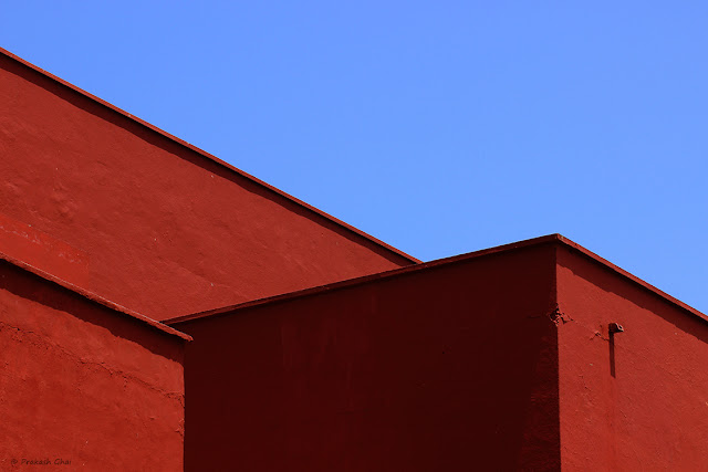 A Simple Minimal Photo of Red Walls against the Blue Sky, Shot via Canon 600D and Canon 100mm Prime Macro F 2.8 L Series Lens.