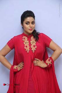 Actress Poorna Latest Stills in Red Dress at Rakshasi First Look Launch  0037.JPG