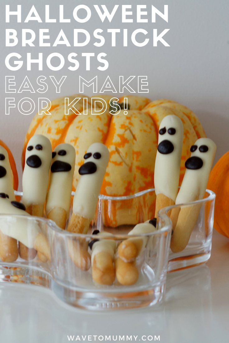 A very simple and quick recipe to do for a Halloween party - ghost breadsticks! All you need is breadsticks, white chocolate, dark chocolate and a piping bag. Kids love these, and easy for kids to make too.