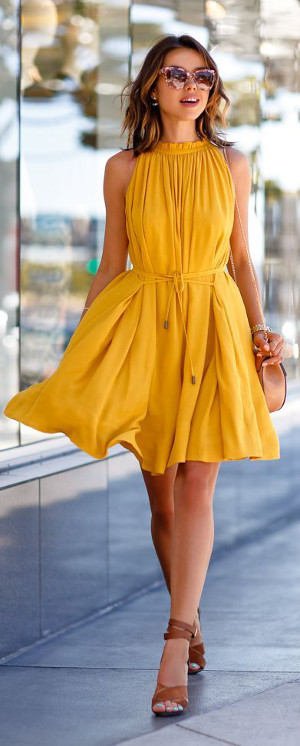 yellow dress and brown shoes