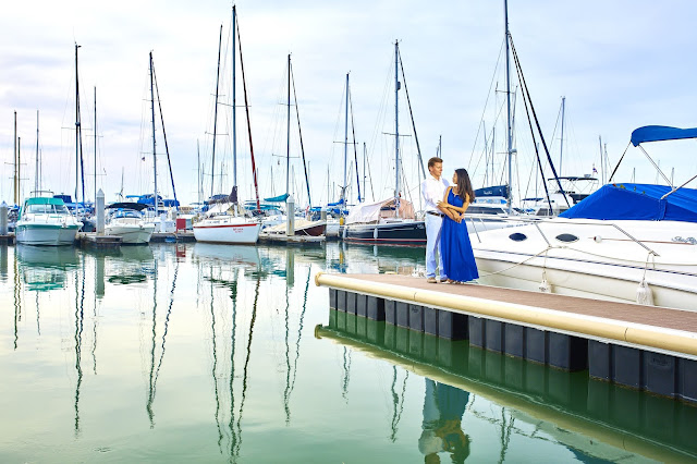 Sailing boats are behind the Couple on Honeymoon Vacation