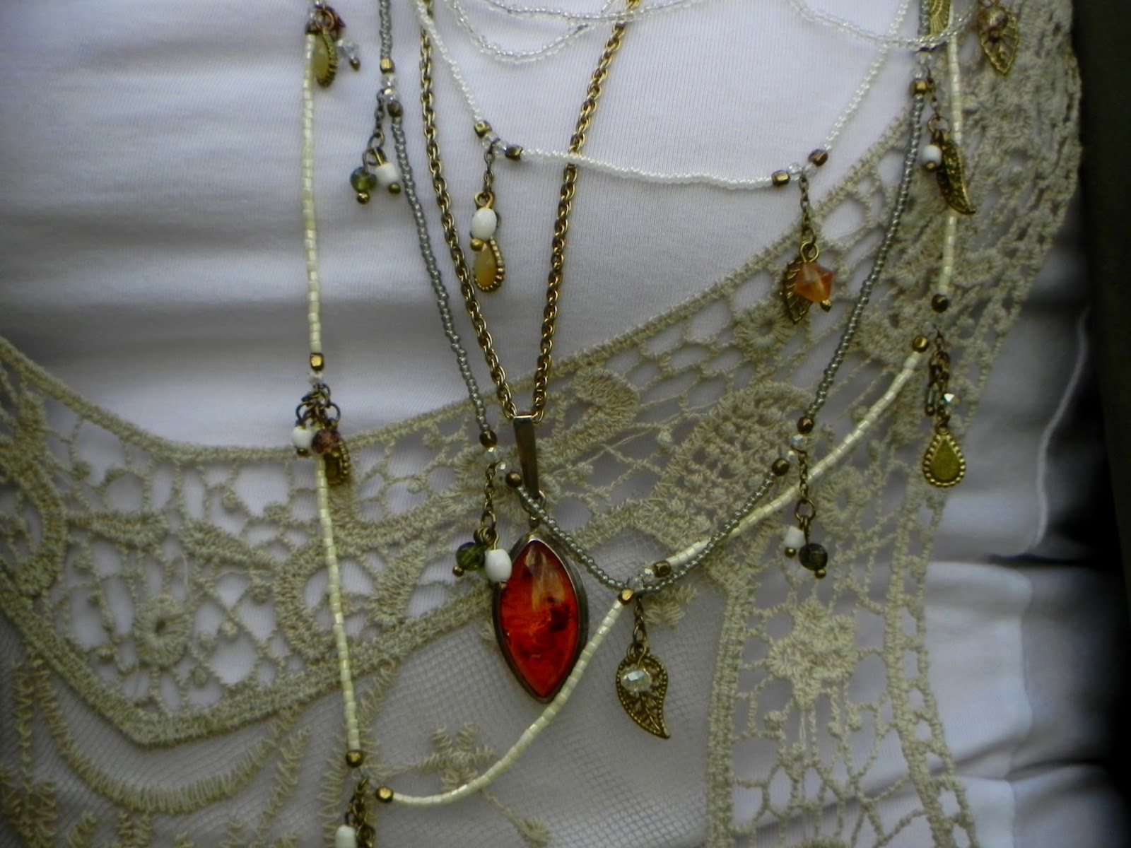 Layered necklaces, Amber and lace.