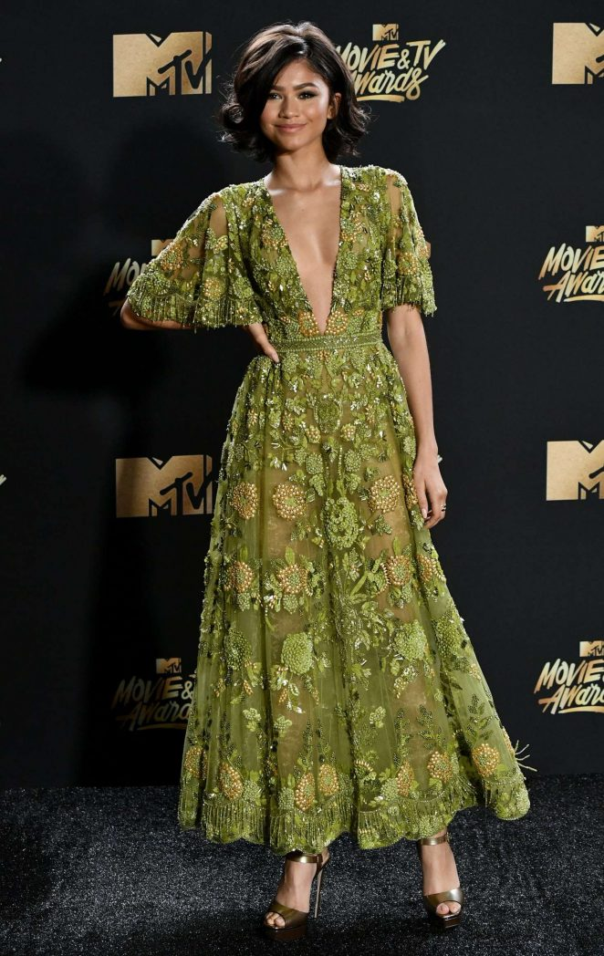 Zendaya wears a sheer plunging dress to the 2017 MTV Movie and TV Awards