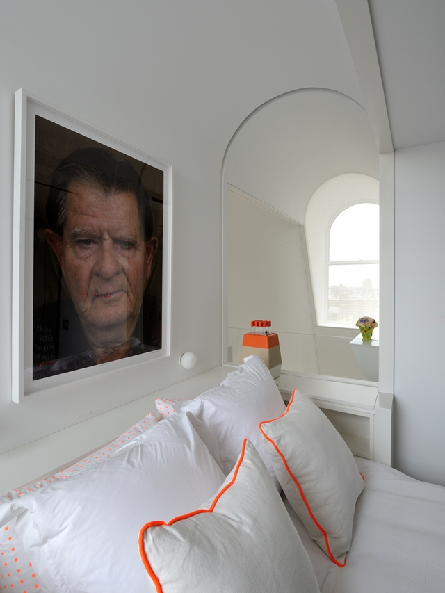 Small window in the bedroom and portrait on the wall