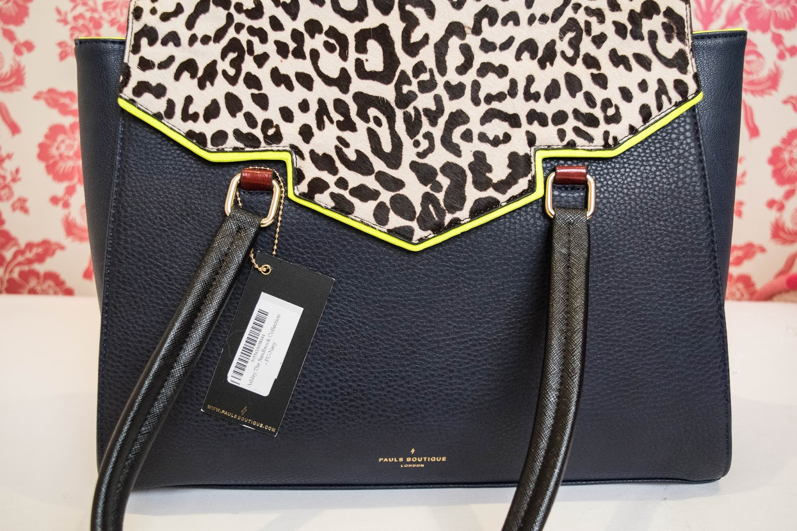 157c0e7329b I m a big fan of leopard print, and as soon as I saw this bag I knew it was  the one. It s made with soft black leather, so looks very professional, ...