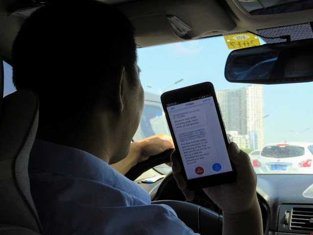 Wild Great Wall Driver giving us a pep talk via a mobile app on our way to the Mutianyu Great Wall of China