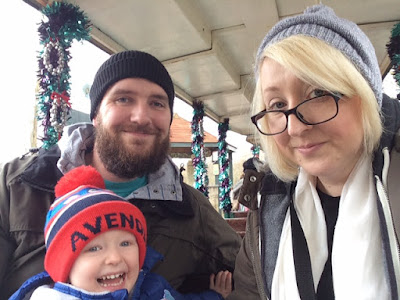 Mummy, Daddy and little boy on a theme park land train