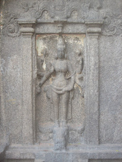 Durga- Featured on one side of the Trimurthi cave temple in Mahabalipuram India