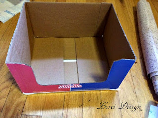 How to recycle a box into a food storage lid organizer.