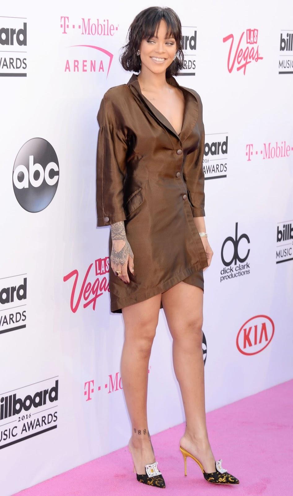 Rihanna wears a silk shirt dress to the Billboard Music Awards 2016