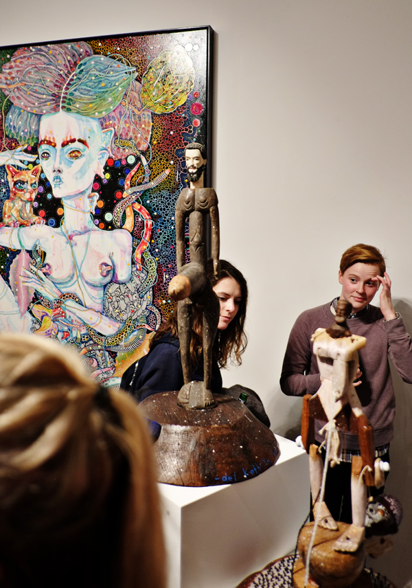 Large phallus and man sculpture, painting detail and opening night crowd at Roslyn Oxley9 gallery for 'angel dribble' by Del Kathryn Barton.