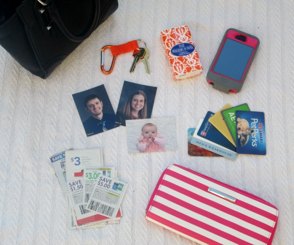 Creative homemade gift idea for a one year old: a purse with old cell phone, wallet with photos and credit cards, and car keys