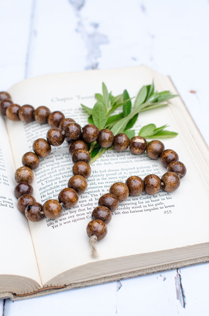 Wood bead garland on vintage book