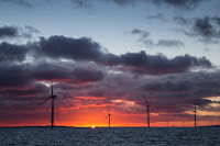 An offshore wind farm in the United Kingdom. (Credit: Aaron Crowe/flickr) Click to Enlarge.