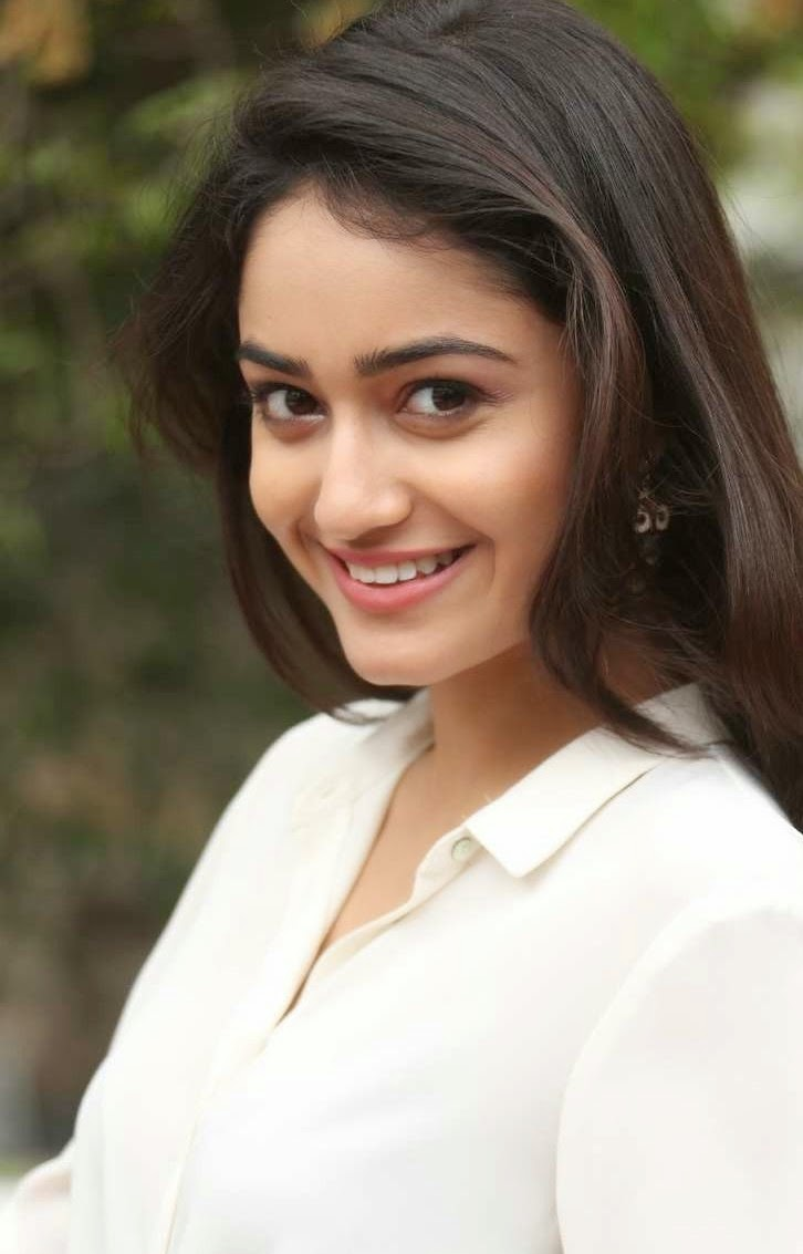 Glamorous Bengali Girl Tridha Choudhury Long Hair Photos In White Dress