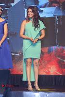 Actress Isha Koppikar Pos in Green Dress at Keshava Telugu Movie Audio Launch .COM 0045.jpg