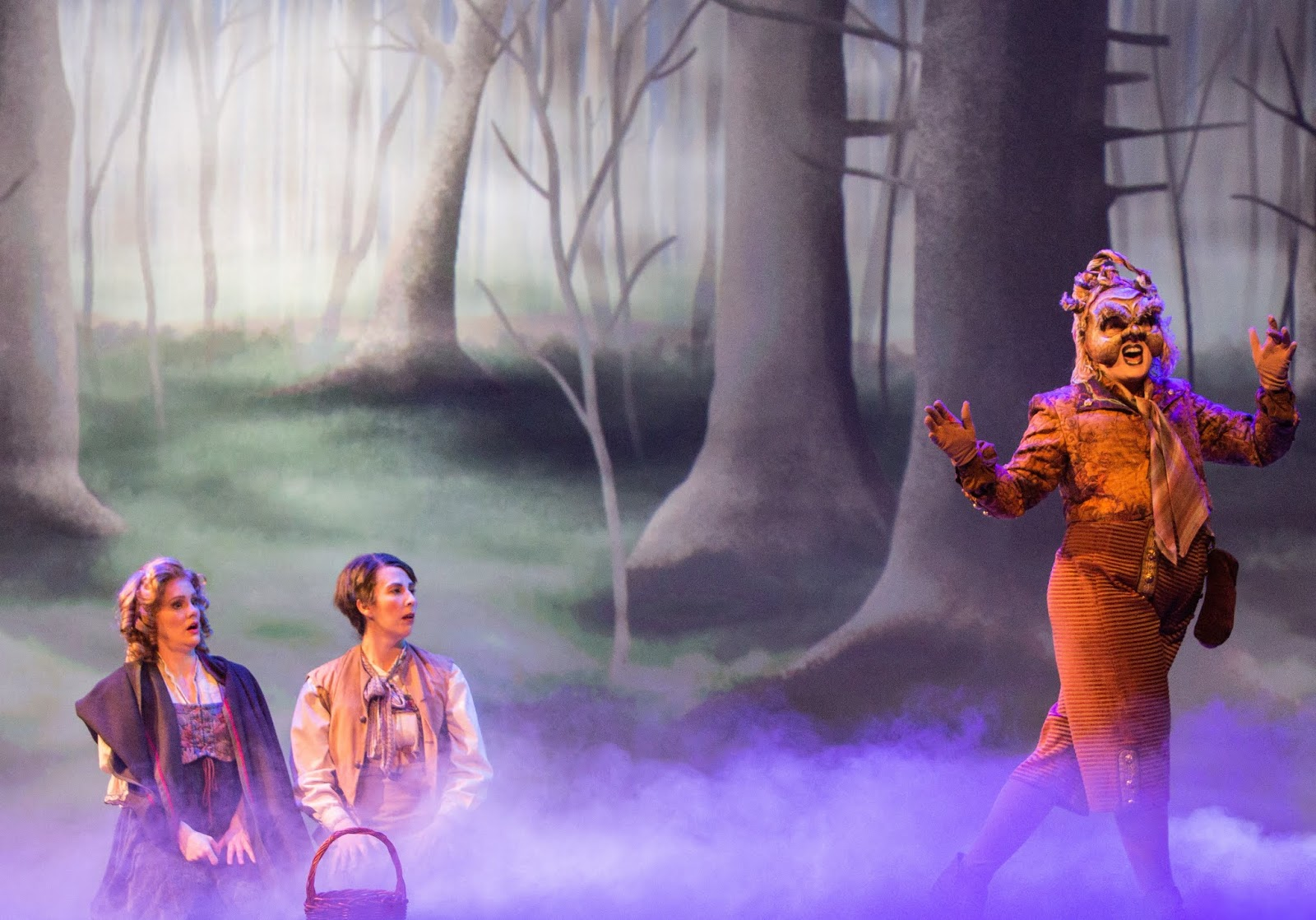 IN PERFORMANCE: (left to right) soprano JOANN MARTINSON DAVIS as Gretel, mezzo-soprano STEPHANIE FOLEY DAVIS as Hänsel, and soprano JORDAN WINSLOW as Der Sandmännchen in Greensboro Opera's March 2019 production of Engelbert Humperdinck's HÄNSEL UND GRETEL [Photograph © by VanderVeen Photographers]