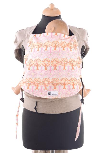 Wrap Tai by Huckepack, stufenlos mitwachsende Babytrage, breit auffächerbare Träger, ergonomisch geformter Hüftgurt, viele Designs erhältlich.