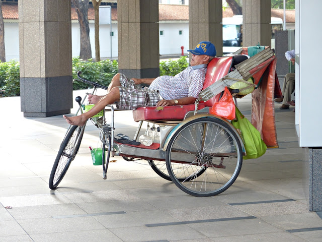Rickshaw taking a nap on the streets of Singapore