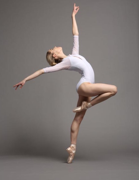 Reaching for the stars in a white eleve leotard