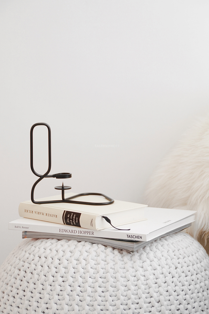 HAY Lup candle holder on books and pouf; fall decoration in black and white
