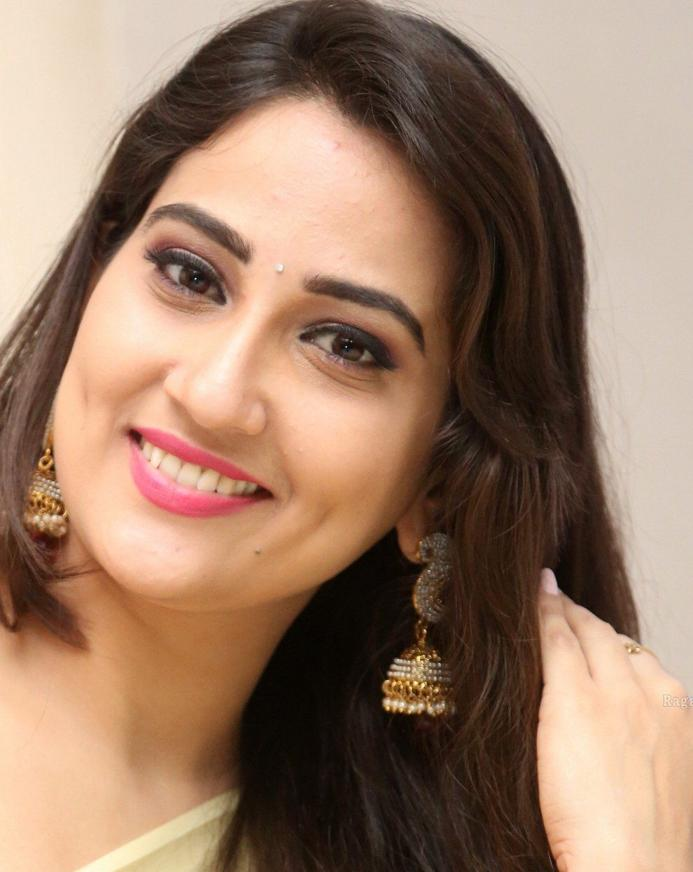 Telugu TV Anchor Manjusha Long Hair Face Close Up Stills