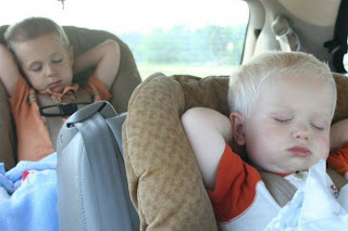 kids sleeping in the car