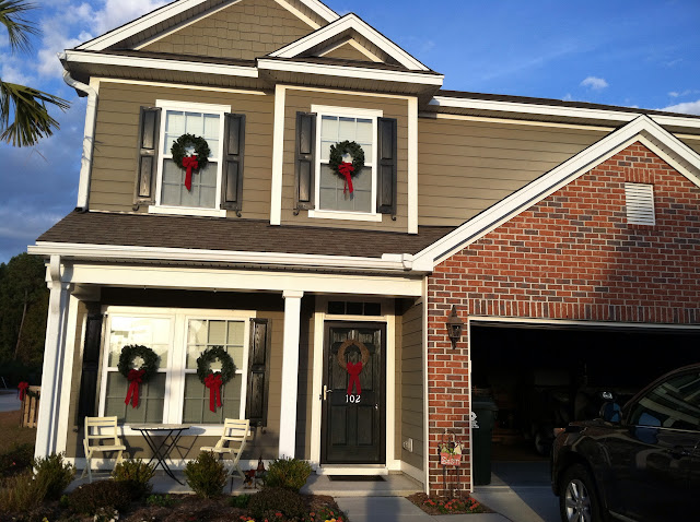 Modern traditional Southern Christmas decorations simple window wreaths with red ribbon | The Lowcountry Lady