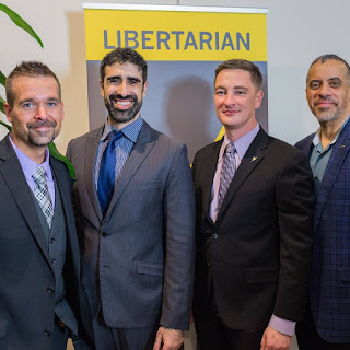 Liberty Link Media's Nicholas Veser with LP Vice Chair Arvin Vohra, LP Chair Nicholas Sarwark, and 2016 LP Presidential candidate Larry Sharpe