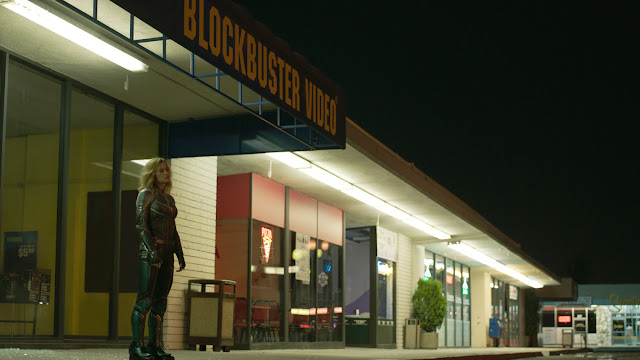 woman standing outside a blockbuster video