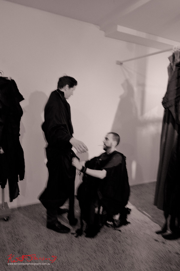 Customer being fitted for BLACK | KṚṢṆA at the launch of Brand X Creative Retail Residency, photo by Kent Johnson.