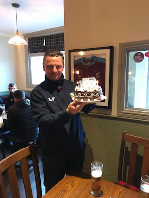 Picture: Lee Fielden with the cake presented to him in 2018 to mark his 500th game as manager of Barnetby United Football Club - see Nigel Fisher's Brigg Blog