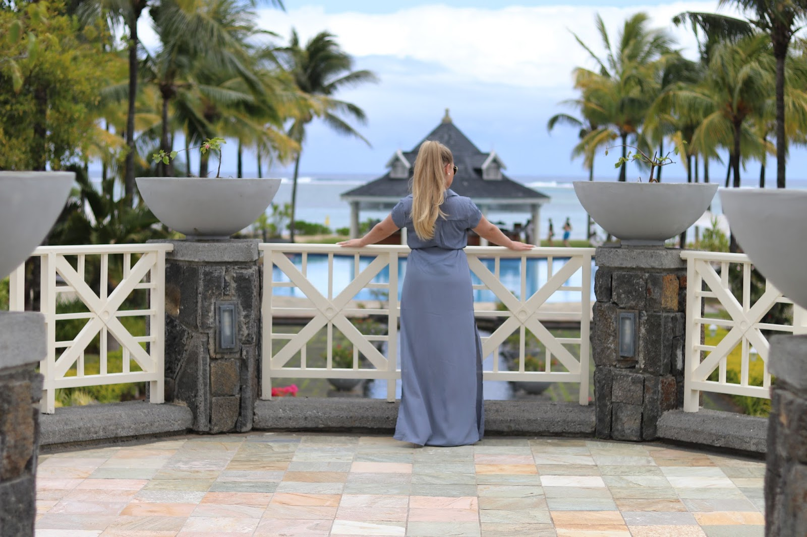 Katie Heath wearing a Boohoo dress at the Heritage Le Telfair Hotel, Mauritius