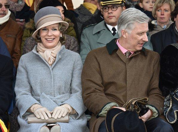 Queen Mathilde and King Philippe attended the Krakelingen Festival held in Geraardsbergen. Queen Mathilde wore Natan coat and Natan boots