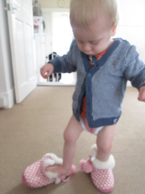 Alexander trying on Lily's slippers
