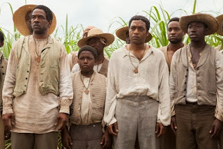 Chiwetel Ejiofor as Solomon Northup and other plantation slaves, in 12 Years a Slave, directed by Steve McQueen