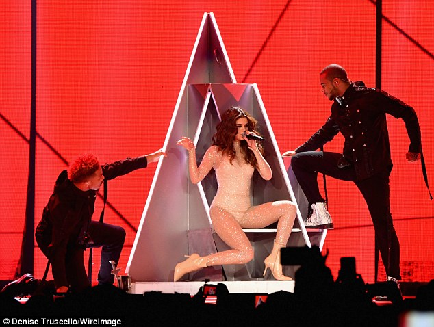 Selena Gomez smoulders in sheer catsuit on Revival Tour
