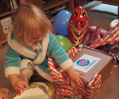 Opening the kids parcel on her third birthday