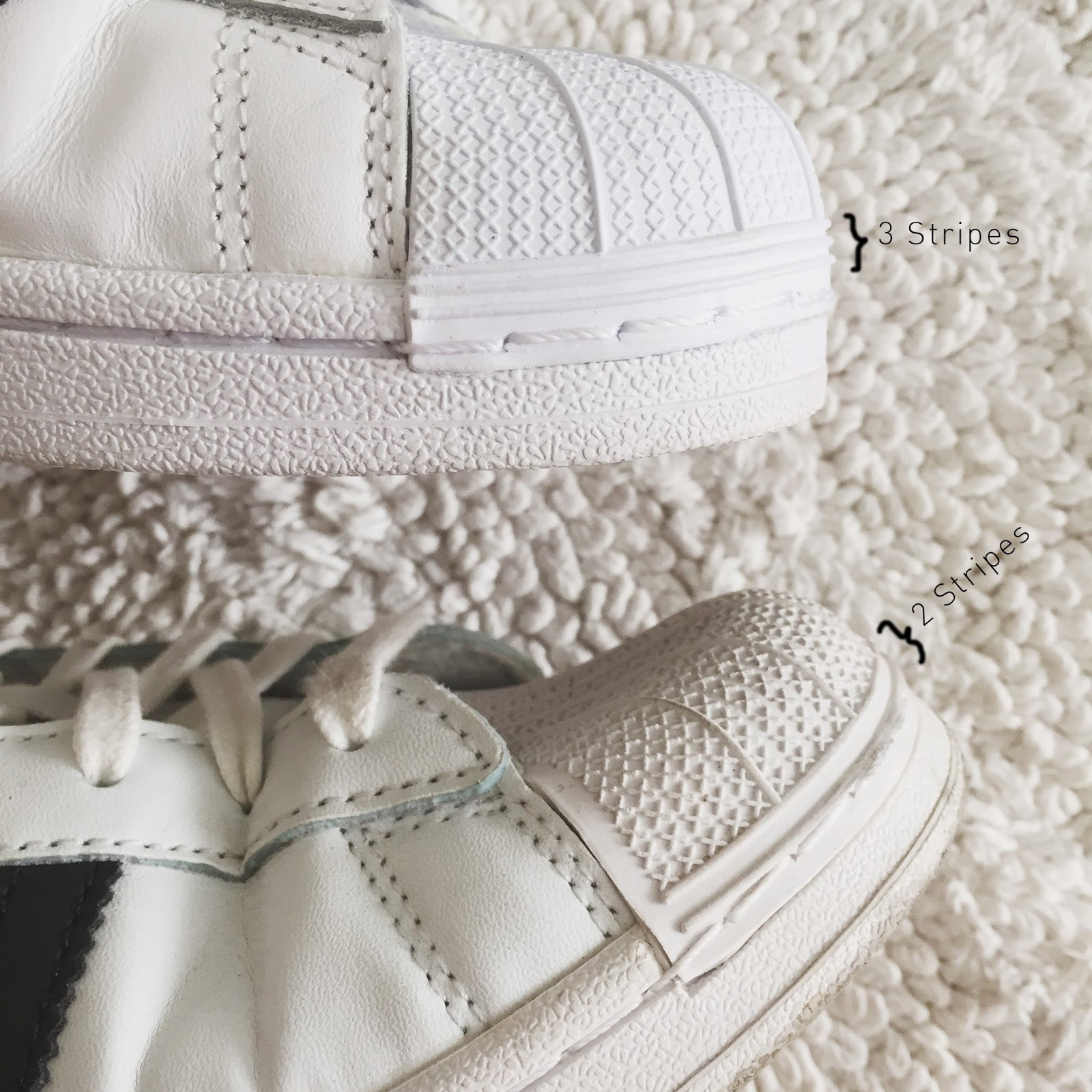Fake: Two rubber stripes at the base of shell toe, different shape